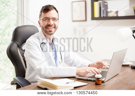 Friendly Hispanic Doctor In An Office