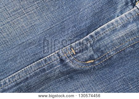 Detail of blue jeans crotch with yellow stitch