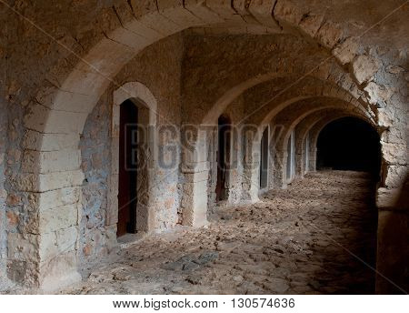 Ancient passage leading to priest rooms in the Famous Arkadi Christian orthodox monastery in Crete Greece