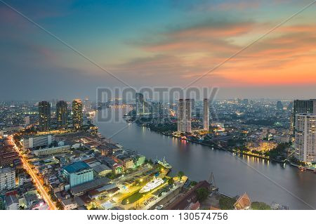 Sunset over River curved in Bangkok city, Thailand