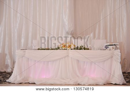 Table for groom bride godfather godmother on a wedding day
