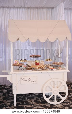 Candy bar with many cakes in natural light