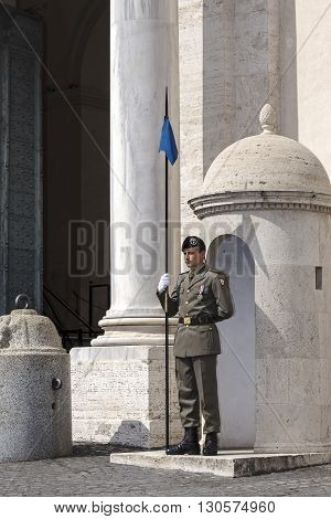 Rome Italy - May 19 2016: Piazza del Quirinale a soldier guarding the entrance of the Quirinale palace.