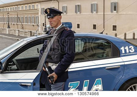 Rome Italy - May 19 2016: Piazza del Quirinale policeman on guard at the entrance of the Quirinale palace.
