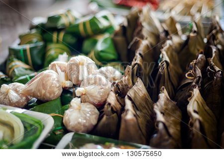 Fresh made thai Khanom tako made with coconut milk. Traditional thai dessert served in banana leaf.