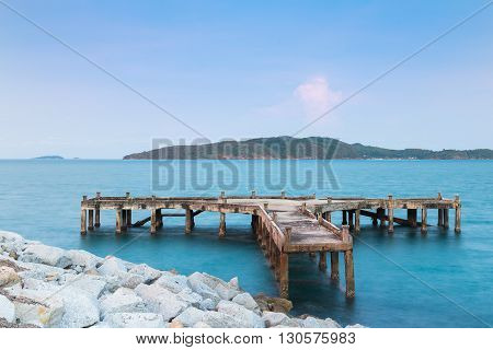 Abandon fishing port with small island background
