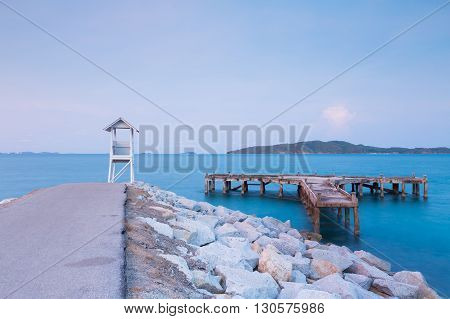 White small lifeguard on the sea port, natural skyline landscape background