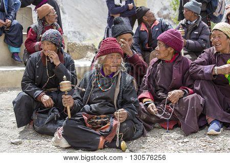 LAMAYURU INDIA - JUNE 13 2015: Unidentified buddhist old people during mystical mask dancing Tsam mystery dance in time of Yuru Kabgyat Buddhist festival at Lamayuru Gompa Ladakh North India