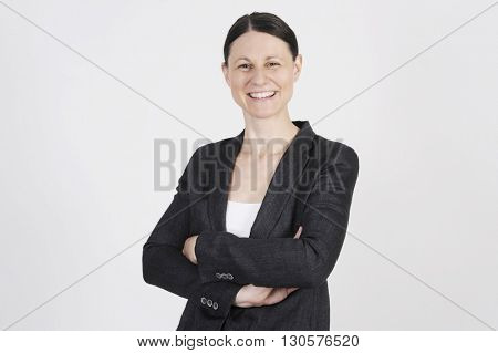 Nice business woman is standing self-confidently in the office