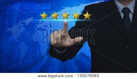 Businessman pressing five yellow stars to increase rating over map and city tower Feedback concept Elements of this image furnished by NASA