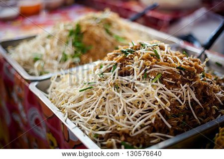 Stir fried noodles with bean sprouts egg prawns and peanuts. Traditional thai cuisine.