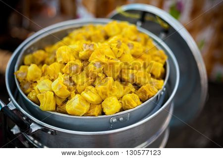 Fresh made asian dumplings Dim Sum filled with minced meat. Traditional thai cuisine.