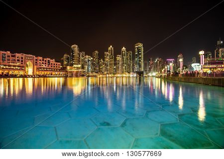 View from the water on high-rise buildings with beautiful reflection on the water