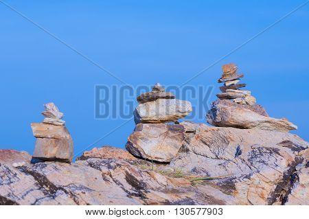Stack stones with clear blue sky background, natural landscape background