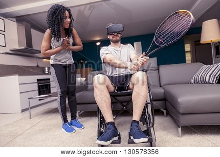 Young Girl Helps A Disabled Who Plays Tennis With Augmented Real