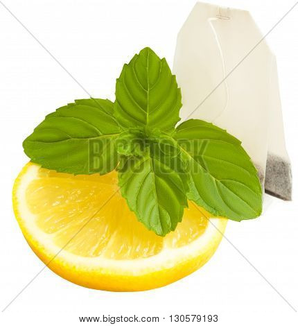 A set for relaxed tea break : slice of yellow lemon green mint leafs tea bag. Isolated on white background. Concept healthy food and relax. Citrus peppermint and teabag ready for brewing tea. Good for health rich of vitamins.