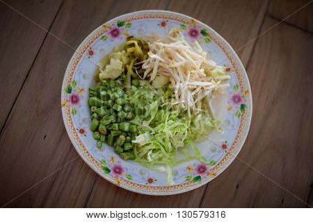 Selection of fresh vegetables - bean sprouts bean cabbage and pickle Traditional thai cuisine.
