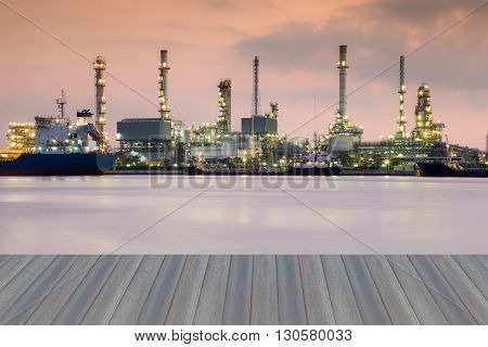 Opening wooden floor, automative refinery waterfront during sunrise