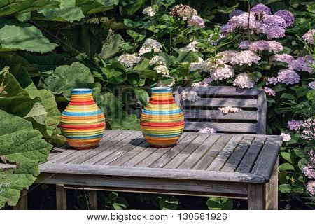 Decorative vase placed on a table in the garden.