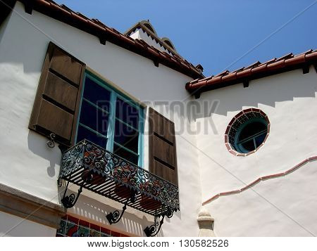 a picture of an exterior 1920's Spanish revival  house