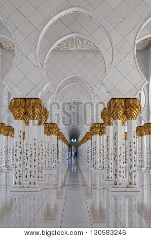 ABU DHABI, UAE - APRIL 17, 2014: Beautiful marble columns of Shiekh Zayed Grand Mosque on April 17, 2014, Abu Dhabi, United Arab  Emirates.