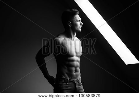 Muscular Man Near Window