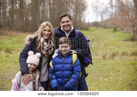 Waist up portrait of family together in the countryside