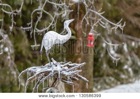 icy sculpture of seagul with red lantern in the background