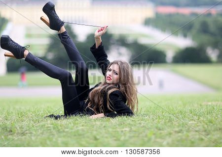 Stylish Young Girl On Grass