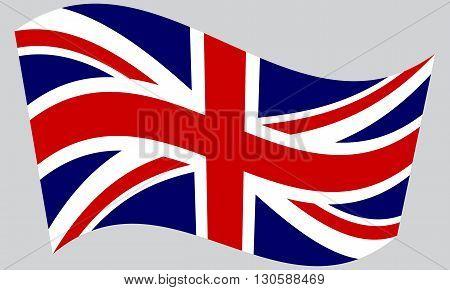 Flag of the United Kingdom waving on gray background