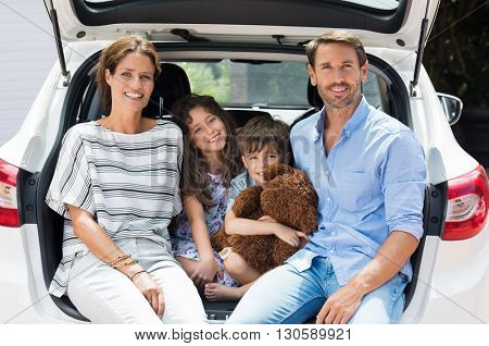 poster of Family car trip on summer vacation. Happy smiling parents and two children in car having fun. Cute s