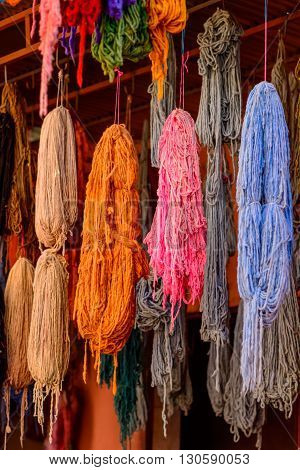 Bundles of dyed wool drying in the souks of Marrakech.