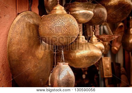 Selection of traditional lamps on sale at a market stall in souks of Marrakech Morocco.