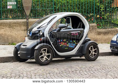 Paris, France - May 13: The Renault Twizy is a battery-powered 2 seat electric city car designed and marketed by Renault on the streets of Montmartre May 13, 2013 in Paris, France.