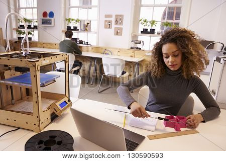 Female Designer Measuring Model In 3D Design Studio