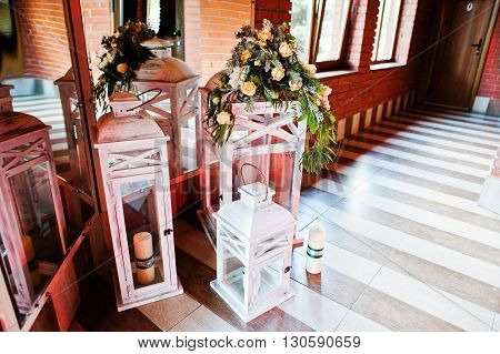 Elegance Wedding Reception Decor. Vintage Wooden Candlesticks With Candles