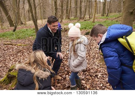 Family exploring nature together in a wood, close up