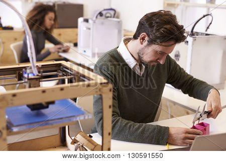 Designer Measuring Model In 3D Design Studio