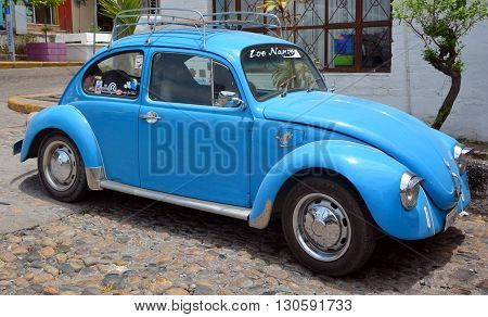 PUERTO VALLARTA MEXICO MAY 11 2016: Volkswagen Beetle or Bug is a two-door, four passenger, rear-engine economy car manufactured and marketed by German automaker Volkswagen (VW) from 1938 until 2003.