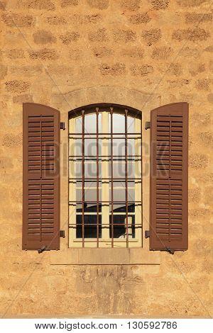 old window with shutters in stone wall, Jaffa, Tel Aviv, Israel. vertical image