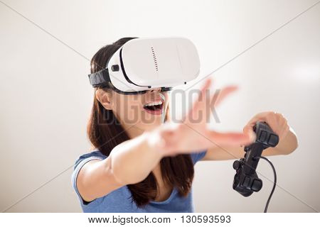 Asian Woman play game on VR device