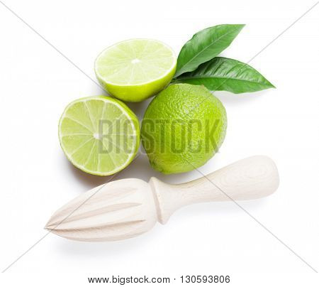 Fresh ripe limes and juicer. Isolated on white background. Top view