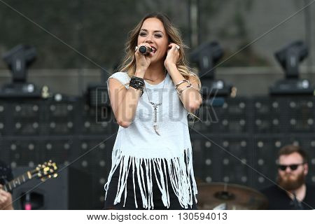 FRISCO, TX-APR 24: Singer Jana Kramer performs onstage during the 2016 Off The Rails Music Festival - Day 2 on April 24, 2016 at Toyota Stadium in Frisco, Texas.