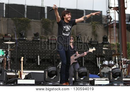 FRISCO, TX-APR 24: Singer Chris Janson performs onstage during the 2016 Off The Rails Music Festival - Day 2 on April 24, 2016 at Toyota Stadium in Frisco, Texas.