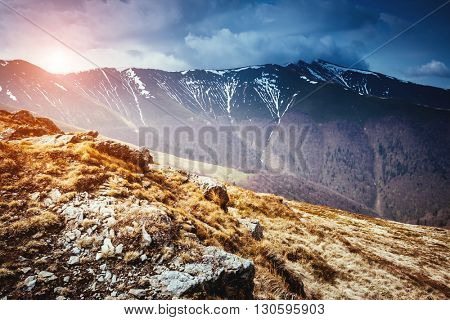 Great view of the snow range which glowing by sunlight. Dramatic and picturesque scene. Location place Carpathian, Ukraine, Europe. Beauty world. Retro and vintage style. Instagram toning effect.