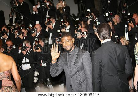 Usher  leave the 'Hands Of Stone' premiere during the 69th annual Cannes Film Festival at the Palais des Festivals on May 16, 2016 in Cannes, France.