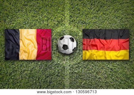 Belgium Vs. Germany Flags On Soccer Field