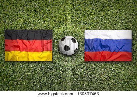 Germany Vs. Russia Flags On Soccer Field
