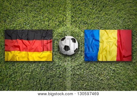 Germany Vs. Romania Flags On Soccer Field