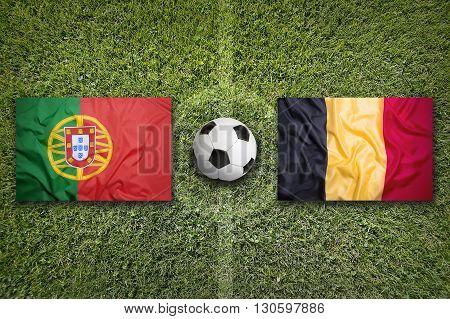 Portugal Vs. Belgium Flags On Soccer Field